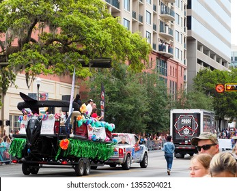 Tallahassee, FL/USA - March 30, 2019: Parade float and Proof truck along parade route on Monroe Street