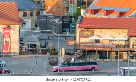 Tallin, Estonia - 24 July 2018: Tallinn. View of the city from the seaport. A long limousine is driving along the street