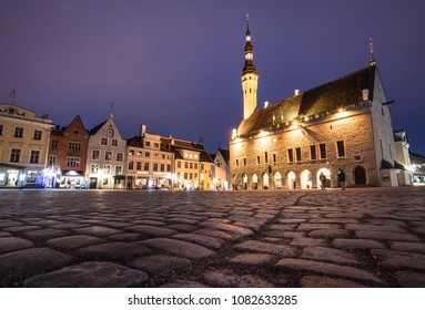 The Tallin gothic Town Hall building on the main old town square at night in Estonia capital city in winter. Tallinn is a popular travel destination in North Europe.