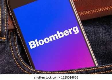 Tallinn / Estonia - 02/22/2019: Black phone with logo of news media Bloomberg on the screen. News media icon. Denim jeans background