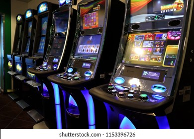 Tallinn, Estonia -08-05-2018: A slot machine is a casino gambling machine with three or more reels which spin when a button is pushed. Slot machines are also known as one-armed bandits