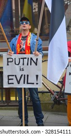 TALLINN ESTONIA 09 27 2015: Anti-Russian against V.Putin protest in connection with military aggression of Russia against Ukraine and flight MH317 Malaysian air line in front the Russian embassy.