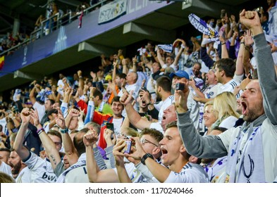 TALLINN, ESTONIA - 15 August, 2018: Fans of Real Madrid in the stands celebrate goal scored during the final 2018 UEFA Super Cup match between Atletico Madrid vs Real Madrid, Estonia