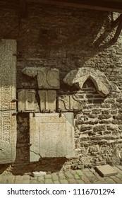 TALLINN, ESTONIA - Ancient tombstones from St Catherine's Dominican Monastery, St. Catherine's Passage, The Old Town of Tallinn