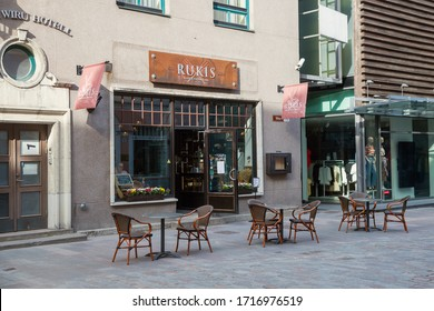 Tallinn, Estonia - APR 27, 2020: Chairs and tables on Viru street at cafe in the Old Town of Tallinn