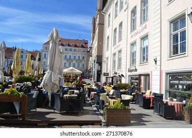 TALLINN, ESTONIA - APRIL 20, 2015: Street cafe in Old Town of Tallinn.