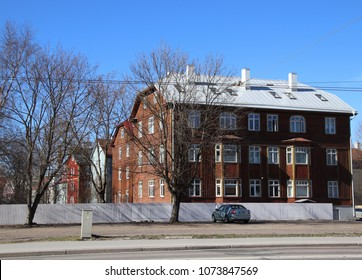 TALLINN, ESTONIA - APRIL 21, 2018: Stylish old brown building starts a row of vintage buildings in perpective on sunny spring day. There are many well maintained old residential buildings in Tallinn.