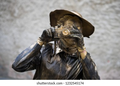 """Tallinn, Estonia - April 7, 2016: an extremely cool living statue """"The Photographer"""" at the streets of the old town of Tallinn."""