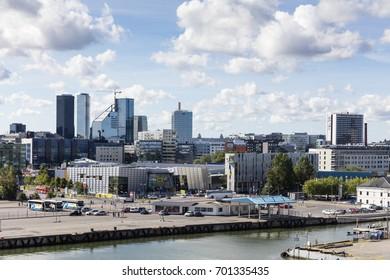 TALLINN, ESTONIA - AUGUST 15. 2017. Modern office buildings and hotels in central  Tallinn seen from the sea.