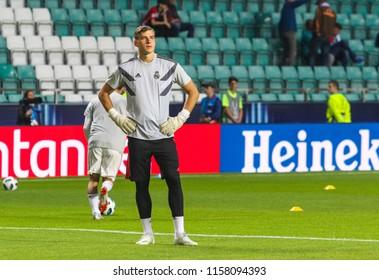 TALLINN, ESTONIA - AUGUST 15, 2018: Ukrainian professional footballer Andriy Lunin during the match 2018 UEFA Super Cup Real Madrid - Atletico at the stadium A. Le Coq Arena