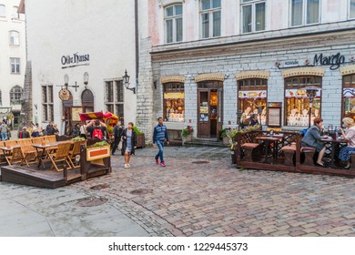 TALLINN, ESTONIA - AUGUST 23, 2016: Restaurants on a cobbled street in the old town in Tallinn.