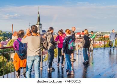 TALLINN, ESTONIA - AUGUST 23, 2016: People watch skyline of the old town of Tallinn from Patkuli Viewing Platform.