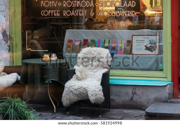 TALLINN, ESTONIA - DECEMBER 11, 2015: Armchair with a table next to the shop (cafe) in the old town of Tallinn