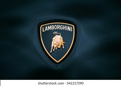 Tallinn, Estonia - December 2, 2016: Close Logo Of Lamborghini. Automobili Lamborghini S.p.A. is an Italian brand and manufacturer of luxury sports cars and SUVs based in Sant'Agata Bolognese, Italy