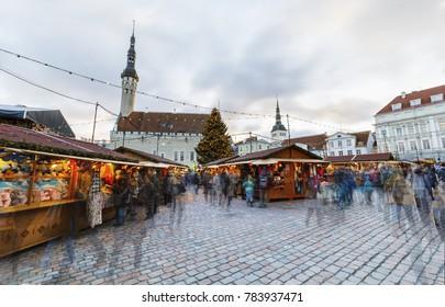 TALLINN, ESTONIA - DECEMBER 24, 2017: Tourists at Christmas market in Tallinn old town in Estonia on December 24, 2017