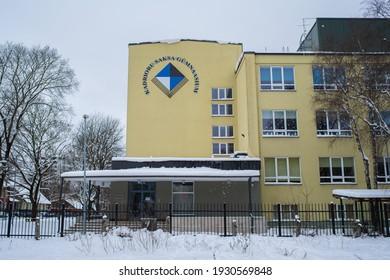 Tallinn, Estonia - February 07 2021: Kadriorg German Gymnasium (Estonian - Kadrioru Saksa Gümnaasium) located in Lasnamae district (Estonian - Lasnamäe). Cloudy winter day. Selective focus.