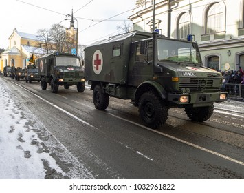 TALLINN, ESTONIA- FEBRUARY24, 2018: Soldiers in a military vehicle with weapons. People are looking how Estonia celebrates its Independence. A parade on Freedom square in Tallinn.