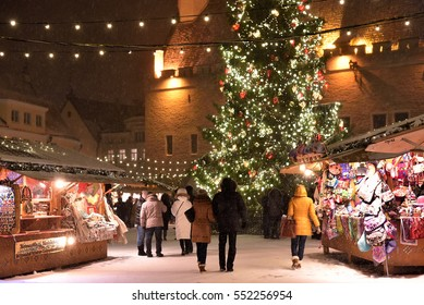 TALLINN, ESTONIA - JANUARY 05, 2017: Unidentified people are walking in old town in Christmas market in Tallinn