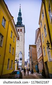 TALLINN, ESTONIA - January 2018: Old town of Tallinn, old narrow streets and ancient buildings. Medieval architecture of Tallinn old town, Estonia