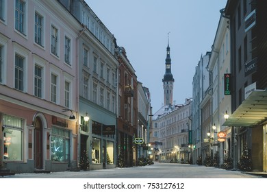 Tallinn, Estonia - January 7, 2017: Viru street - is the main street of the Old Town. On the background is tower of Town Hall. Old Tallinn is part of the UNESCO World Heritage site.