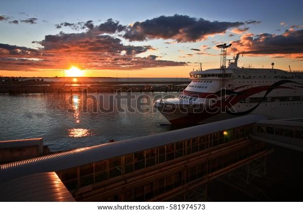 TALLINN, ESTONIA -JUL 19,2016: Modern ferry boat at sunset in the port of Tallinn