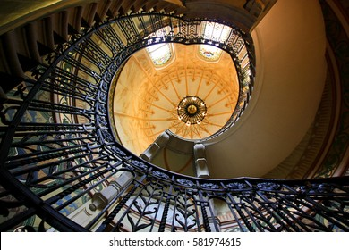 TALLINN, ESTONIA -JUL 20,2016: Estonia pst, Bank of Estonia Museum. Spiral staircase in the hall with stained-glass window