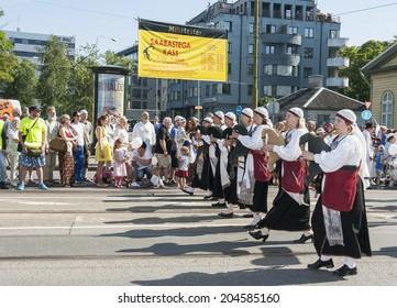 TALLINN, ESTONIA - JULY 05, 2014: Parade of the Estonian XXVI National song and dance festival called Aja Puudutus, Puudutuse Aeg in Tallinn, Estonia on July 05, 2014