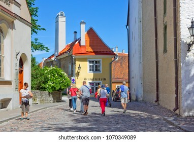TALLINN, ESTONIA - JULY 08, 2017:  Tourists sightseeing on the small street on Toompea Hill