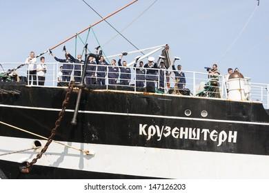 TALLINN, ESTONIA - JULY 12, 2013: Crew of the famous Kruzenshtern or Krusenstern ship greet audience when the ship arrives to Tallinn Maritime Days on July 12, 2013 in Tallinn, Estonia