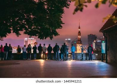 Tallinn, Estonia - July 2, 2019: People Visiting Kohtuotsa Viewing Platform. Cityscape Skyline At Summer Night. View From Patkuli Viewpoint.