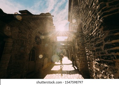 Tallinn, Estonia - July 2, 2019: People Tourists Walking In St. Catherine's Passage From St. Catherine's Dominican Monastery At Summer Day. Historic Old Town Of Tallinn. UNESCO World Heritage Site.