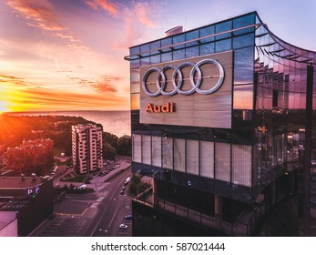 TALLINN, ESTONIA - JULY 2016: Aerial drone shot of the the Audi logo on the outside glass facade on the big office skyscraper building in Tallinn at sunset. Audi is a German automobile manufacturer.