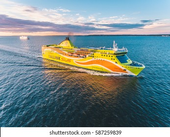 TALLINN, ESTONIA - JULY 2016: Aerial shot of the Tallink Shuttle MS Superstar cruise ferry going from Helskinki to Tallinn at sunset.