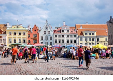TALLINN, ESTONIA - JULY 21, 2018: Tourists visiting and shopping at Town Hall Square (Raekoja Plats) in old town