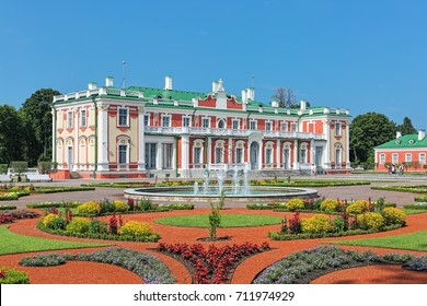 TALLINN, ESTONIA - JULY 27, 2016: Kadriorg Palace and flower garden with fountain. Kadriorg Palace is a Petrine Baroque palace built for Catherine I of Russia by Peter the Great in 1718-1727.