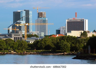 TALLINN, ESTONIA - JULY 8, 2017: Modern office buildings and hotels in central downtown Tallinn as seen from the sea.