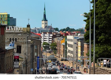 TALLINN, ESTONIA - JULY 9, 2017: View of St. Nicholas church in Old Town of Tallinn and city center from the bus station on Tartu street.