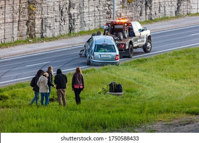 Tallinn, Estonia - June 06, 2020: car accident. Tow truck pulls broken car
