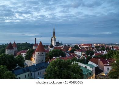 Tallinn, Estonia - June 27 2016: Historical center of Tallinn at summer night. A look from Toompea hill towards the church of St. Olaf.