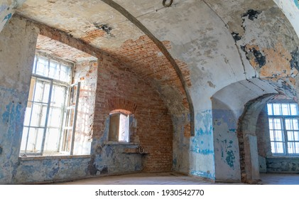 Tallinn Estonia - March 04 2021:  Interior of the third floor of Patarei Sea Fortress (also prison, The Battery). Internal wall are removed revealing long arched corridors. peeling off paint.