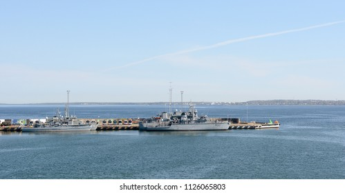 TALLINN, ESTONIA - May 13, 2018: Lithuanian Naval Force minehunter ships LNS Suduvis M52 and LNS Skalvis M53 at the Port of Tallinn. Paljassaare district is visible across the water.