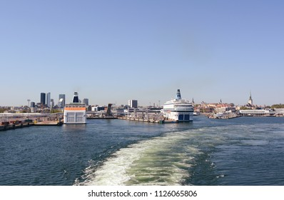 TALLINN, ESTONIA - May 13, 2018: On board a ferry leaving the Port of Tallinn. Cruise ferries are docked in the harbour and the city of Tallinn, a UNESCO World Heritage site lies beyond.