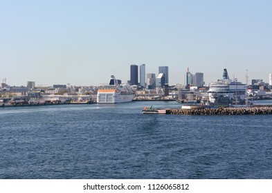 TALLINN, ESTONIA - May 13, 2018: Ferries docked at terminals in the Port of Tallinn, the biggest port authority in Estonia. The city can be seen beyond the harbour.