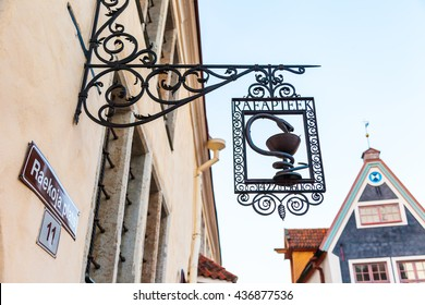 Tallinn, Estonia - May 31, 2016: signboard of old pharmacy museum of Tallinn on the Town Hall Square in the Historical Center of city. Tallinn, Estonia.