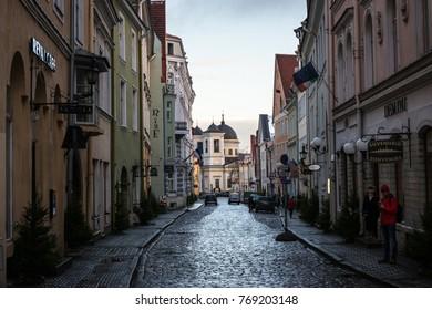 TALLINN, ESTONIA - NOVEMBER 25 2017: Narrow street in Tallinn??s old town in a cold Autumn morning, Estonia, on November 25, 2017.
