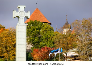 TALLINN, ESTONIA - OCTOBER 05, 2019: Glass made statue of liberty and colorful trees in autumn in Tallinn, Estonia in October 2019
