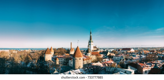 Tallinn, Estonia. Panoramic View Of Part Of Tallinn City Wall With Towers, At Top Of Photo There Is Tower Of Church Of St. Olaf Or Olav. Old Walls of Tallinn. Popular Place