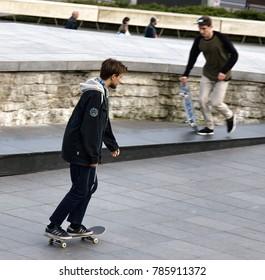 Tallinn, Estonia - September 1, 2017: boy skateboarding on street training site