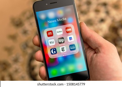 Tallinn / Estonia - September 18, 2019: Black Apple iPhone with icons of News media: BBC, Forbes, CNN, WSJ, WP, Bloomberg, Guardian, NY Times and Euronews applications on screen. News media icons.
