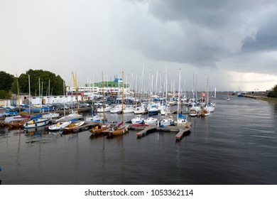 TALLINN, ESTONIA- SEPTEMBER 7, 2015: Parking of small size vessels, yachts in the Tallinn Pirita Harbour and Kalev Yacht Club, the sky with dark clouds